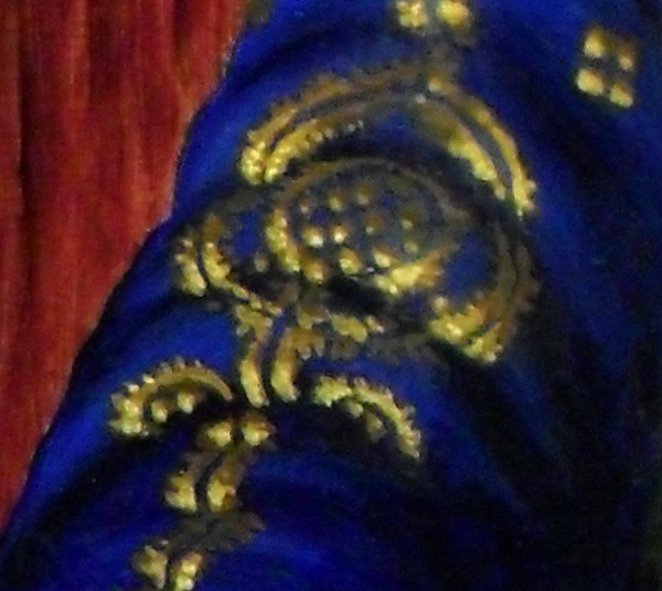 Close-up of the blue and gold brocade on the top of her right sleeve. On the left hand side, you can see the grain of the wood in the background (the wood that I have painted - the support surface for the actual painting, the Italian poplar is buried under layers of gesso and oil paint). Copyright (c)2016 Paul Alan Grosse